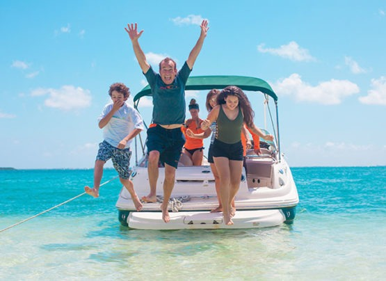 family enjoying cayman's island