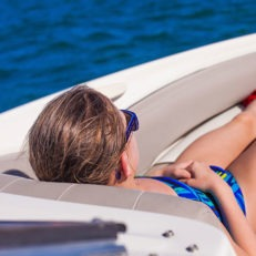 guy enjoying a boat trip in grand cayman